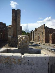 Guidebooks don't explain that in Pompeii, you see mostly the shell of the great city, its walls, fountains, bars, temples.